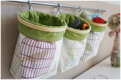 Cloth bags held open with embroidery hoops on curtain rod