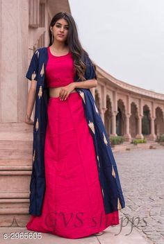 Kurta Sets Women Rayon Solid Crop Top Kurti With Skirt Fabric: Top - Rayon Jacket - Rayon Skirt - Rayon Sleeves: Top - Sleeves Are Not Included Jacket - 3/4 Sleeves Are Included  Size: Top - S - 36 in M - 38 in L - 40 in XL - 42 in XXL - 44 in  Jacket - S - 36 in M - 38 in L - 40 in XL - 42 in XXL - 44 in  Skirt - S - 28 in M - 30 inL - 32 in XL - 34 in XXL - 36 in Length: Top - Up To 18 in Jacket - Up To 50 in Skirt - Up To 38 in Type: Stitched Description: It Has 1 Piece Of Top 1 Piece Of Jacket & 1 Piece Of Skirt Work: Jacket - Printed Pattern: Top - Solid Skirt - Solid Country of Origin: India Sizes Available: S, M, L, XL, XXL   Catalog Rating: ★4.3 (249)  Catalog Name: Women Rayon Solid Crop Top Kurti With Skirt CatalogID_404344 C74-SC1003 Code: 095-2965605-7491