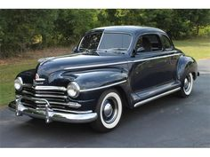 This car is similar to Joe's 1950s Plymouth, his is black as well- our car to the reception. :)