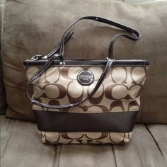 CUTE Coach purse Cute coach shoulder/tote bag, previously worn with only one minor flaw on backside of bag (please see pics), but other than that it is still in great condition and comes from a smoke free home :) Coach Bags Shoulder Bags