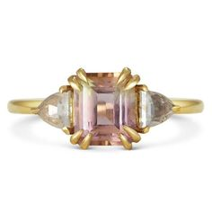 Michelle Oh Rosa engagement ring, set with an octagonal bi-colour tourmaline with triangular rose cut diamond side stones in 14 carat yellow gold  #bridal #engagementring #diamond #pink #michelleoh