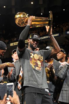 LeBron James of the Cleveland Cavaliers celebrates with the Larry O'Brien NBA Championship Trophy after winning Game Seven of the 2016 NBA Finals against the Golden State Warriors on June 2016 at. Get premium, high resolution news photos at Getty Images Lebron James Cavs, Lebron James Cleveland, Lebron James Tattoos, Nba News, News 2, Fan Image, Nba Trade Rumors, Nba Scores, Nba Championships