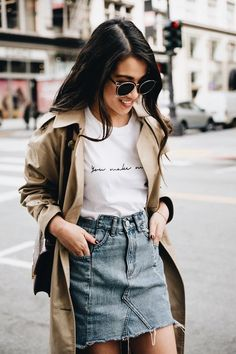 Beige trench coat over white tee and denim mini skirt. http://spotpopfashion.com/au6m