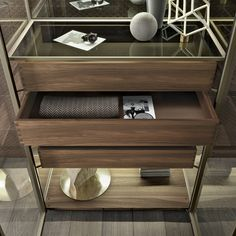 sideboard Alambra with structure in palladio aluminum, doors, side panels, and back panel in refl ective clear glass, top in mat lacquered palladio glass, shelf in transparent grey glass, suspended drawers in walnut with special dovetail assembling