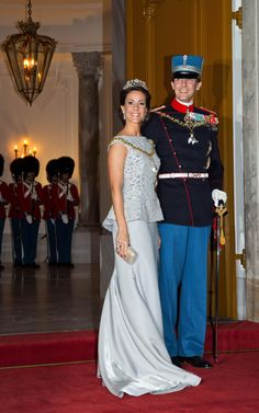 Princess Marie and Princess Mary of Denmark wear tiaras for Denmark's traditional New Year's banquet