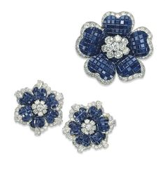 I wonder if I could bead something in this style, must give it a try! A GROUP OF SAPPHIRE AND DIAMOND FLOWER JEWELLERY, BY VAN CLEEF & ARPELS   1969 (brooch), 1975 (ear clips), signed   Van Cleef & Arpels