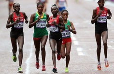 Ethiopian and Kenyan marathon runners, from left, Edna Ngeringwony Kiplagat, Tiki Gelana (won gold), Mary Jepkosgei Keitany (4th place), Mare Dibaba and Priscah Jeptoo (Won silver). I love our African women.