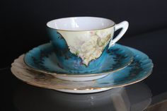 Stunning vintage fine china teacup, trio. Matching saucer, teacup and side plate. Turquoise blue, white, cream and lilac, floral image and