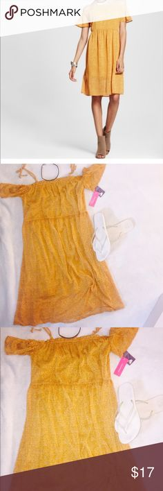 NWT yellow polka dot off shoulder dress Chiffon polka dot off the should knee length dress is perfect for the hot summer days. This dress is NWT and is more of a mustard yellow than bright yellow. Xhilaration Dresses