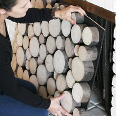 Check out this reader's ingenious solution for the look of stacked logs in the fireplace, without taking away the functionality to easily have fires when they want. | thisoldhouse.com/yourTOH
