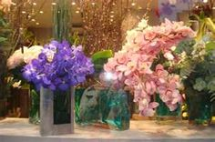 Flower display in shop window, Paris, France