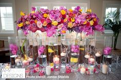 Welcome table with submerged crystals, tulpis, and floating candles. The long flower arrangement across the top and small accents on the table are exquisite. #unique @janaeshields