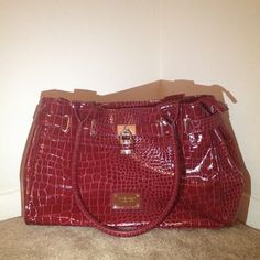 Snake print purse by Nine West Excellent condition , hardly worn  Nine West Bags Totes