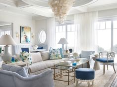 The living room's Oly chandelier floats above a glass coffee table. The sofa is from Lee Industries; window treatments are Duralee sheers. - Photo: Emily Jenkins Followill / Design: Melanie Followill
