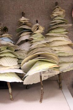 book page and twig trees. Ornaments, stuck in foam for table decorations... your imagination is only limitation!