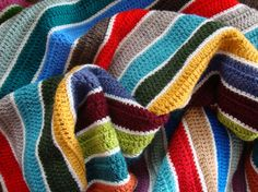 Colorful crocheted stripes with a thin white stripe in between. Brilliantly simple.