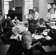 Reporters for the New York Amsterdam News at work in the newsroom, 1936. Photo by Lucien Aigner.