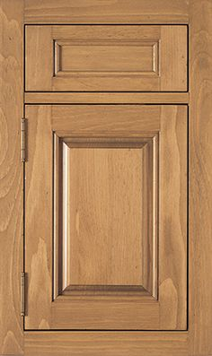 Cambridge Raised door style by #WoodMode, shown in Toast finish on pine.