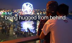 being hugged from behind