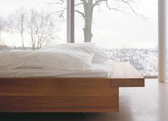 Solid oak bed NOAH by Philippe Allaeys with extended frame on both sides acting as a shelf. / www.e15.com #e15 #solidwood
