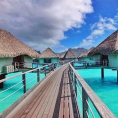 Walking over the turquoise waters at Le Meridien Resort in Bora Bora, French Polynesia. Photo courtesy of mthiessen on Instagram.