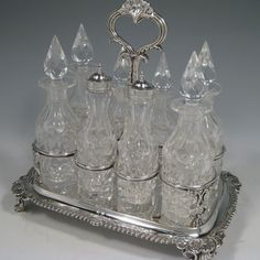 Antique Georgian sterling silver and hand-cut crystal eight-bottle cruet set, made by Robert Hennell II of London in 1833.