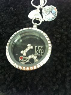"""Origami Owl """"Love my dog"""" locket .... FREE CHARM WITH A $25 OR MORE PURCHASE... Contact me to place your order YourCharmingLocket@gmail.com or message me on Facebook https://www.facebook.com/YourCharmingLocket. Want more than just one locket, consider joining our team for an extra income."""