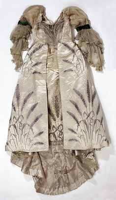 Ball Gown, House of Worth 1893, French, Made of silk.  Rather unusual ball gown in that it has full sleeves.