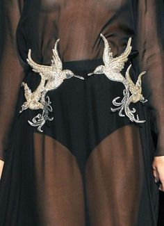 love the embroidered detail on this sheer Gucci dress