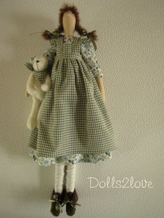 Tilda doll Summer wearing a dress with a print of by Dolls2love