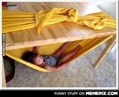 A Hammock in the fort under the table! Man, I wish I small kid again!