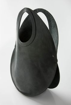 Vincent Urbain (Urban Africa): Leather Eggtail Bag ~ Hard Version. Handles reinforced with 4 lines of stitching. Two compartments that hold plenty, but a bit more than the Fishtail Bag. 400 mm in diameter.  http://media-cache-ec0.pinimg.com/originals/b0/10/e3/b010e3796f9e5678160c7550ebfa308f.jpg  http://media-cache-ec0.pinimg.com/originals/05/91/f8/0591f86ba42a0a8cd00bc891cab4ca5f.jpg http://www.urbanafrica.co.za/products/leather-bags/eggtail.jpg/