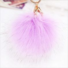 Faux Fox Fur Fluffy Ball Keychain. Click Picture to Purchase. https://liftingtheworld.com/collections/fluffy-balls-keychains