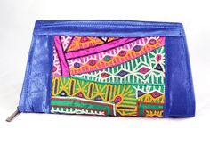 Handmade Embroidery clutch is beautifully made from vintage fabric that are heavily decorated with mirror sequins, beads and thread Embroidery work. It has two pockets inside, in which one main pocket with zip , inner pocket has zip and the another one is without zip.