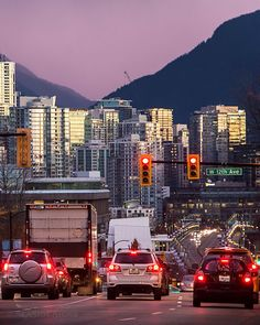 Morning Commute You just have to stop and stare at the beauty of this approach into Vancouver. The glass catching the first light of the sunrise with a purple haze of fog beyond the north shore mountains. Captured on 12th and Cambie in Vancouver British Columbia Canada November 8 2016 Click the LINK in my bio to see the rest of this photo on my Facebook page