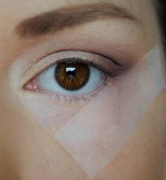 Tape method for perfect eye makeup application. This girl is AWESOME!