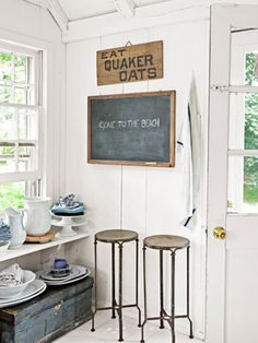 Love this trunk with toppings for storage. The kitchen's garden entrance packs in two 1950s iron stools, a primitive stenciled Quaker Oats ad, and a blue English tradesman's box—which, along with the built-in shelf, corrals platters and pitchers.