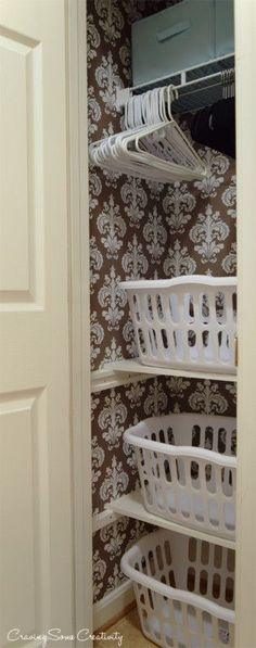 Laundry Closet Makeover - Turning a small broom closet into a functional space with stacked laundry baskets