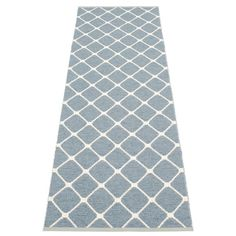 New to the Pappelina family is Rex design. Simple geometrics in dusty blue and white. Practical soft plastic rugs for anywhere in the home. Team it will the matching cushion of the same design. Cool blue Swedish style.