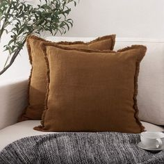 Here's How to Nail the Japandi Interior Design Style Using Amazon Finds | This pillow cover is available in multiple solid colors, including brown, beige, and light green. The linen material and fringed details give it a natural feel that would make a great accent to a sofa or chair. #decorideas #homedecor #decorinspiration #realsimple #smallspaceideas #apartmentideas Green Pillow Covers, Green Pillows, Throw Pillow Covers, Interior Design Principles, Japanese Interior Design, Sofa Couch Bed, Decorating Small Spaces, Decorative Throw Pillows, Brown Beige