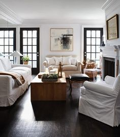white slipcovers, dark floors... and love the black doors