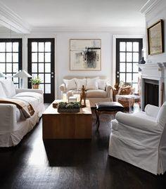 white slipcovers, dark floors... and love the black doors