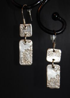 Two section pure silver earrings. Textured and decorated by hand. Joined together and hung from sterling silver wires. Matching pendant