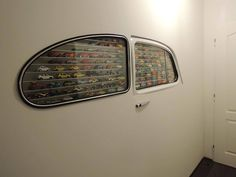 Toy car storage case made from the window  of a #VW #Bug. A great way to show off a #Hotwheels collection.