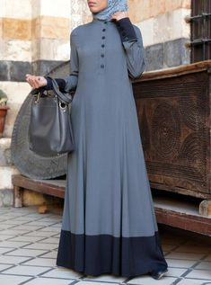 Twotone Long Maxy Abaya This piece is finished with side-slit pockets and buttoned openings and cuffs for a gentle embellishment of an already elegant abaya. Muslim Women Fashion, Islamic Fashion, Mode Abaya, Mode Hijab, Abaya Fashion, Fashion Outfits, Hijab Style Dress, Abaya Style, Abaya Designs