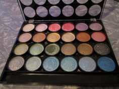 L.A. Colors Private Eye 24 Colour Eyeshadow Palette. Most colours not even swatched (basically just the green one you can see). $10 shipped.