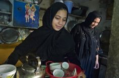 Aftermath of Iraqi war - Zahra, 9, and sister Layla, 24, prepare breakfast for their family at their jome in Sadr City. 2 of 44 year old Halim Daham's six children, their father died in March after nearly 8 yrs of health complications relating to the loss of his legs to U.S. tank fire in 2004.  Now this faimly lives largely on charity from relatives.