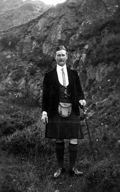 Old photograph of a hill walking guide in the Highlands of Scotland