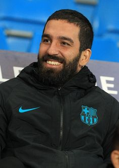 Barcelona's midfielder Arda Turan on the substitute bench during the Champions League Group C stage soccer match between Manchester City FC and FC...