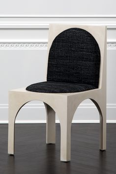 KELLY WEARSTLER   ROXBURY CHAIR. A distinctive dining or occasional chair.
